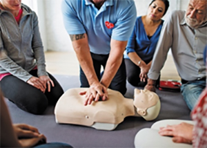 a class member performing cpr on a dummy