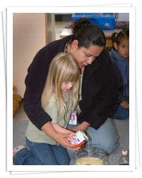 Early childhood education program, student helping a young person
