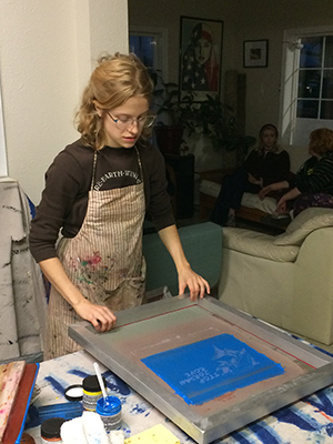 Bella with Rogue Climate working on screen print
