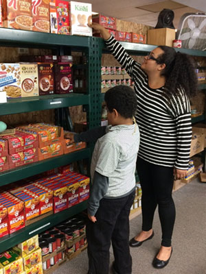 volunteering with her son at the food pantry