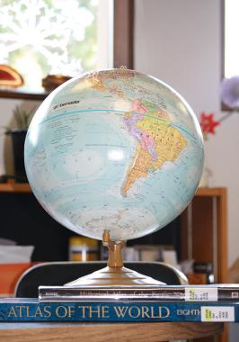 global search for library books illustrated by a globe on a stack of atlases